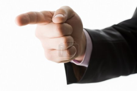 Photo of human hand with forefinger pointing aside