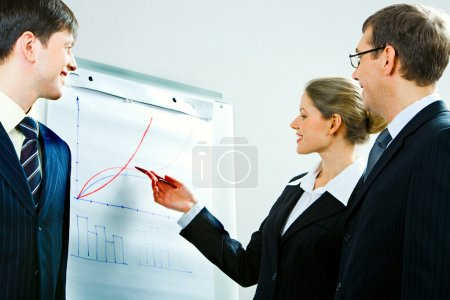 Photo for Image of successful woman explaining a right away of business-plan to her colleagues - Royalty Free Image