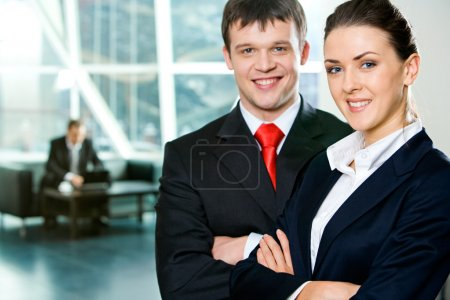 Photo for Portrait of successful business in the suits looking at camera in the modern office - Royalty Free Image