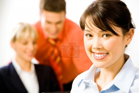 Photo for Face of the attractive business woman on the background of two - Royalty Free Image