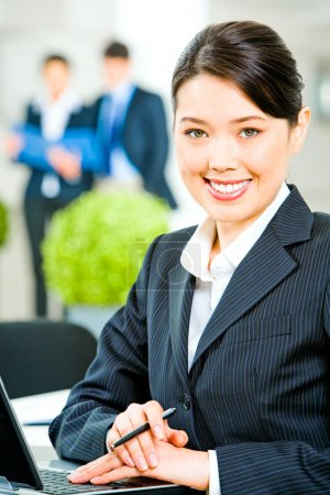 Photo for Portrait of smiling business woman sitting at the table - Royalty Free Image