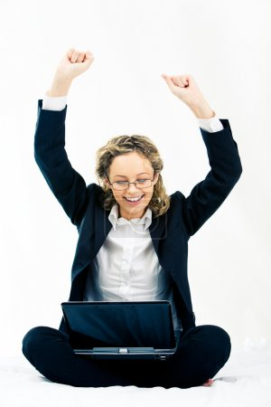 Photo for Portrait of cheerful business woman sitting with raised hands with laptop on her knees - Royalty Free Image
