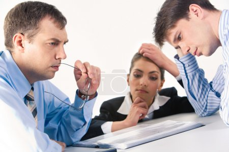 Photo for Image of three professionals thinking about business-plan - Royalty Free Image