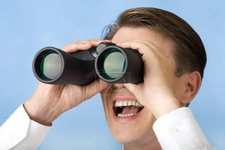 Photo for Close-up of happy businessman watching through binoculars - Royalty Free Image