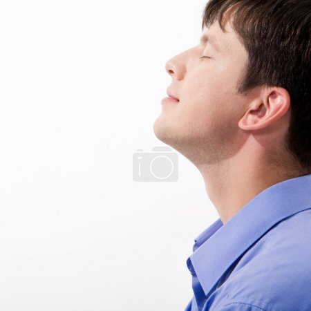 Man's profile keeping his eyes closed in enjoyment