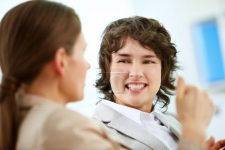 Photo for Smiling business woman looking at her colleague - Royalty Free Image