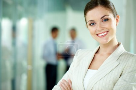 Portrait of a smiling business woman looking confi...