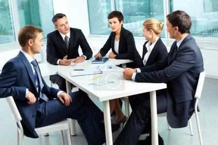 Photo for Image of confident colleagues looking at their boss at meeting - Royalty Free Image