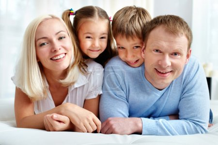 Photo for Portrait of happy family resting at home - Royalty Free Image