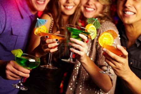 Photo for Young having fun at a party with cocktails - Royalty Free Image