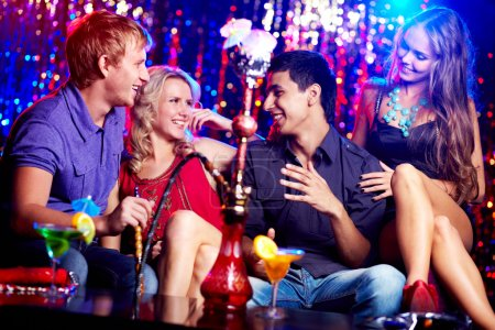 Photo for Image of two happy couples interacting in night club - Royalty Free Image