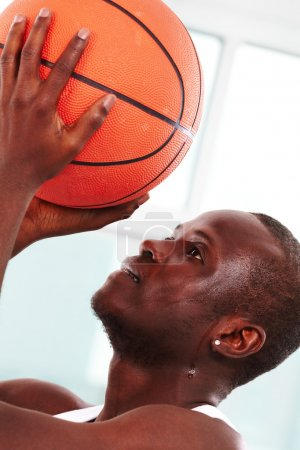 Photo for Image of a basketball player throwing ball into basket - Royalty Free Image