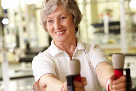Senior lady at gym