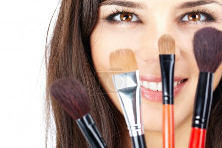 Face behind brushes