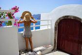 Young woman in straw hat, Santorini island