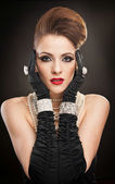 Young beautiful woman in black dress and gloves